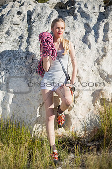 Blonde woman with climbing equipment