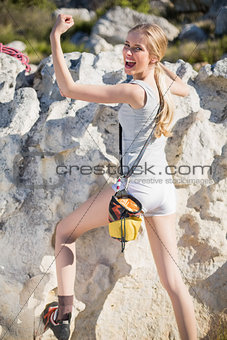 Powerful woman climbing
