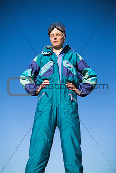 Woman wearing ski suit with closed eyes