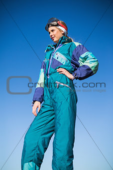 Woman in ski suit with one hand on hip