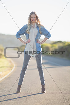 Blonde woman posing on highway