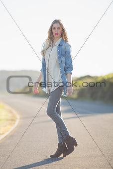 Beautiful woman posing on highway
