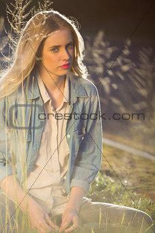 Calm model sitting in grass