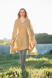 Attractive blonde woman wearing poncho