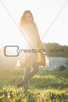 Attractive woman posing in a poncho