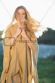 Blonde woman posing in front of camera