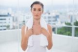 Relaxed sporty brunette holding white towel