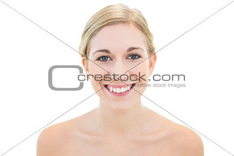 Cheerful young blonde woman posing smiling at camera