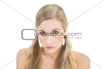 Pouting young blonde model looking at camera