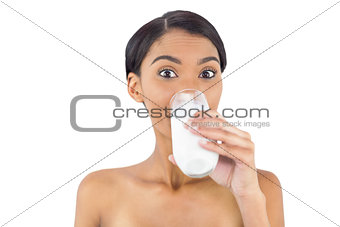 Smiling attractive model drinking milk