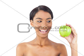 Smiling attractive model holding green apple