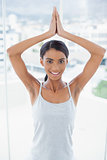Smiling gorgeous model doing yoga exercise