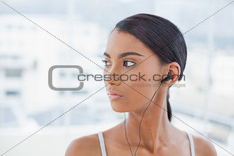 Pensive pretty model listening to music