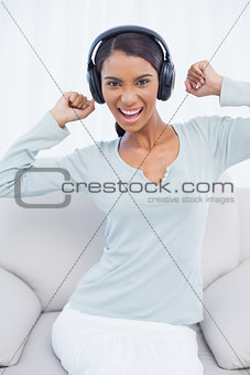 Attractive woman dancing while listening to music