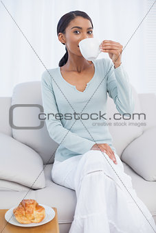 Smiling attractive woman drinking coffee