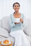 Smiling attractive woman having a breakfast