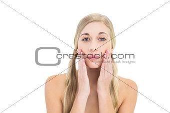 Natural young blonde woman looking at camera