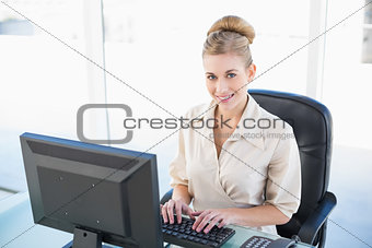 Attractive young blonde businesswoman using a computer