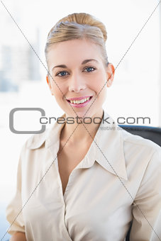 Charming young blonde businesswoman smiling at camera