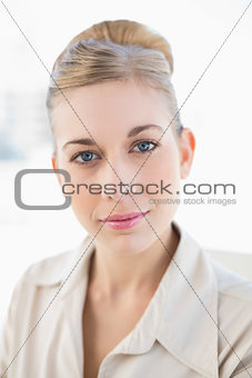 Gorgeous young blonde businesswoman looking at camera