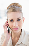 Gorgeous young blonde businesswoman calling with mobile phone