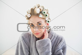 Pensive relaxed blonde woman looking at camera