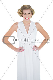 Content fashion blonde model posing with hands on the hips