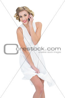 Amused fashion blonde model making a phone call