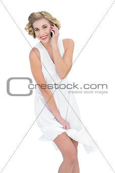 Amused fashion blonde model making a phone call