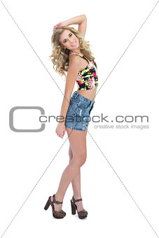 Delighted retro blonde model looking at camera