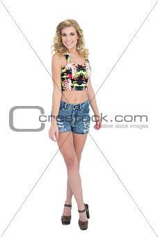 Happy retro blonde model looking at camera