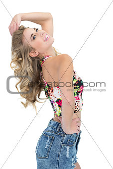 Content retro blonde model posing with a hand on the hip