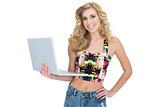 Smiling retro blonde woman using a laptop