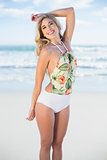 Happy blonde model in swimsuit looking at camera