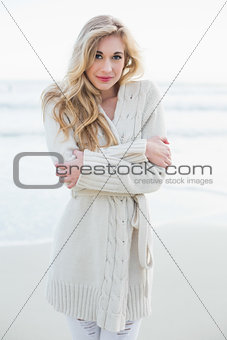 Attractive blonde woman in wool cardigan looking at camera