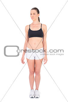 Fit woman in sportswear looking away