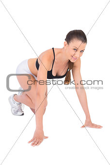 Smiling woman in sportswear preparing for race