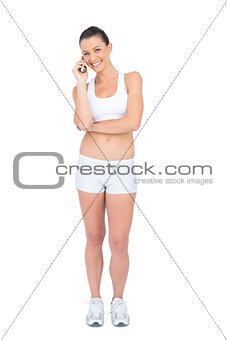 Happy woman in sportswear on the phone
