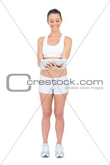 Happy fit woman using tablet computer