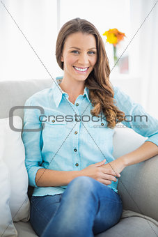 Attractive model sitting on sofa