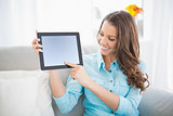 Smiling woman showing her tablet screen