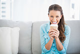 Pretty woman holding cup of coffee