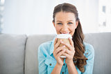 Portrait of attractive woman holding cup of coffee