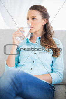 Calm woman drinking water