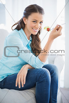 Attractive woman eating healthy salad
