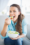 Happy attractive woman eating healthy salad