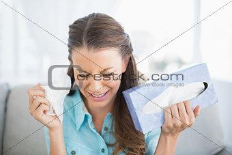 Sad young woman bursting into tears