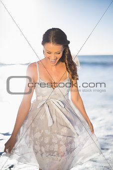 Smiling beautiful woman on the beach