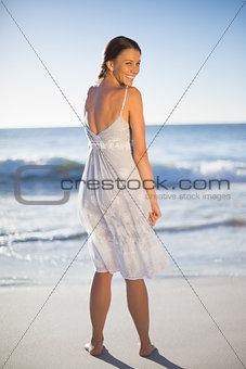 Attractive woman looking over shoulder at camera
