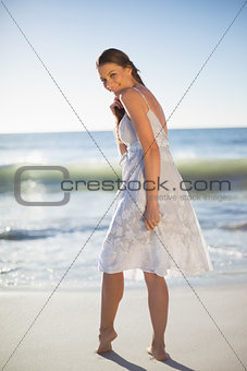 Smiling attractive woman looking over shoulder at camera